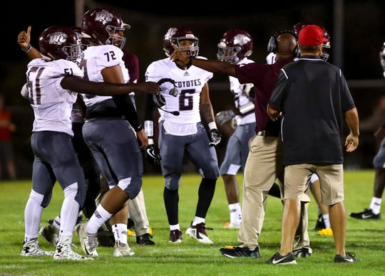 West Creek players are told to move away after a brawl broke out during a high school football game between Montgomery Central and West Creek at Montgomery Central High School in Cunningham, Tenn., on Friday, Aug. 30, 2019.
