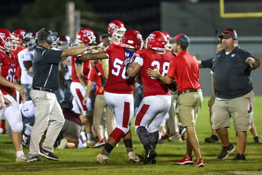 Montgomery Central players are pulled away from a brawl that broke out on the field during a high school football game between Montgomery Central  and West Creek at Montgomery Central High School in Cunningham, Tenn., on Friday, Aug. 30, 2019.