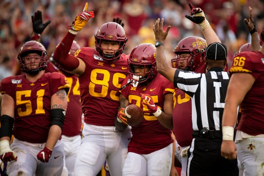 Iowa State celebrates with Iowa State running back Sheldon Croney Jr. (R-Sr.) (25) after he scored the game winning touchdown in triple overtime during their season opening game at Jack Trice Stadium on Saturday, Aug. 31, 2019 in Ames. Iowa State would go on to defeat UNI 29-26.