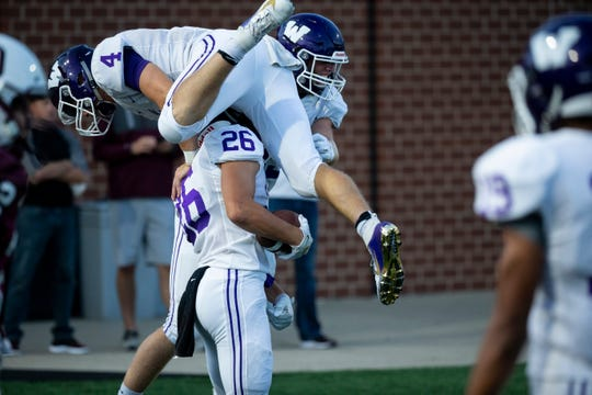 Waukee's Mitch Randall (4) jumps on Waukee's Alexander Linquist (26) after he scored a touchdown during their season opening game at Valley Stadium on Friday, Aug. 30, 2019 in West Des Moines. Waukee takes a 17-14 lead into halftime.