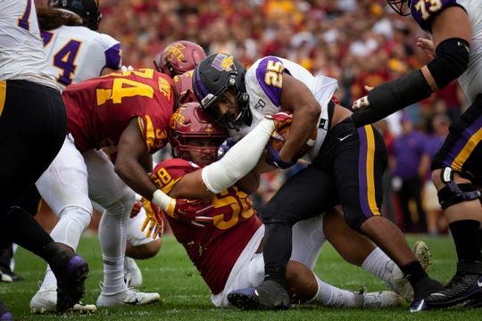 UNI's Trevor Allen (25) is tackled by Iowa State defensive lineman Ray Lima (58) during their season opening game at Jack Trice Stadium on Saturday, Aug. 31, 2019, in Ames.