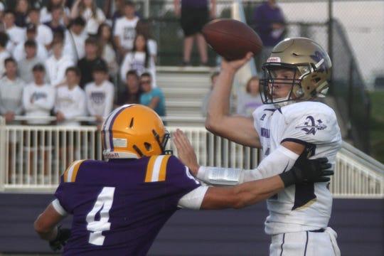 Indianola sophomore linebacker Carter Erickson pressures Norwalk senior quarterback Zachary Marker. Indianola hosted Norwalk in the season opener for both teams on Aug. 30.