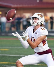 Ankeny's Brody Brecht (11) catches a punt on Friday, Aug. 30, 2019, during the season opening game between the Ankeny Hawks and the Ankeny Centennial Jaguars.
