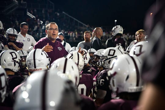 Tom Wilson celebrates the Maroons' victory during a huddle after they defeated the Warriors 21-17 on Aug. 30 at Valley Stadium.