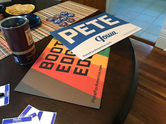 Materials promoting Democratic presidential candidate Pete Buttigieg are placed out as staffers nearby lead an organizing event on Thursday, Aug. 29, 2019, in Iowa City.