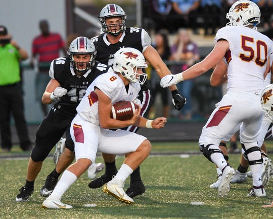 Ankeny's Jase Bauer (8) scrambles up field on Friday, Aug. 30, 2019 during the season opening game between the Ankeny Hawks and the Ankeny Centennial Jaguars.