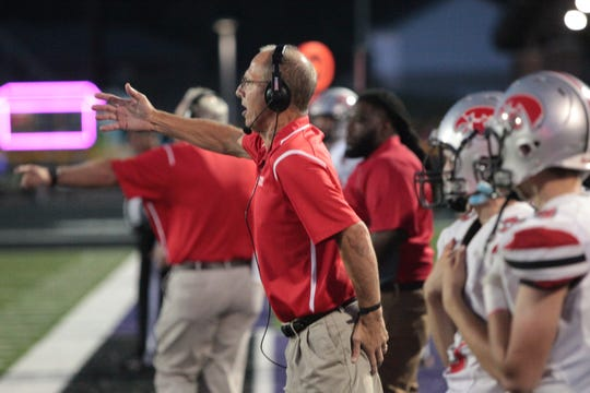 City High head coach Dan Sabers directs his team during their game against Liberty at Liberty High School in North Liberty on Friday, Aug. 30, 2019.