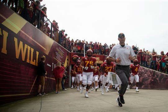 Iowa State head coach Matt Campbell runs out of the tunnel followed by the team before their season opening game at Jack Trice Stadium.