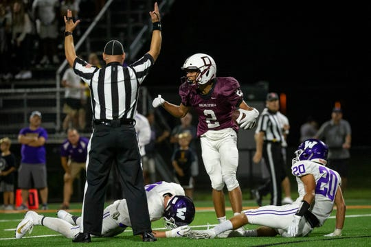 Dowling Catholic's Louis Brooks (2) celebrates a touchdown catch during their season opening game at Valley Stadium on Friday, Aug. 30, 2019, in West Des Moines. Dowling would go on to win 21-17.