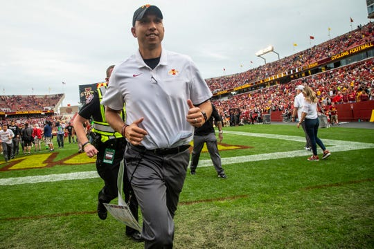 Iowa State head coach Matt Campbell runs off the field after beating UNI 29-26 in triple overtime of their season opening game at Jack Trice Stadium on Saturday, Aug. 31, 2019 in Ames.