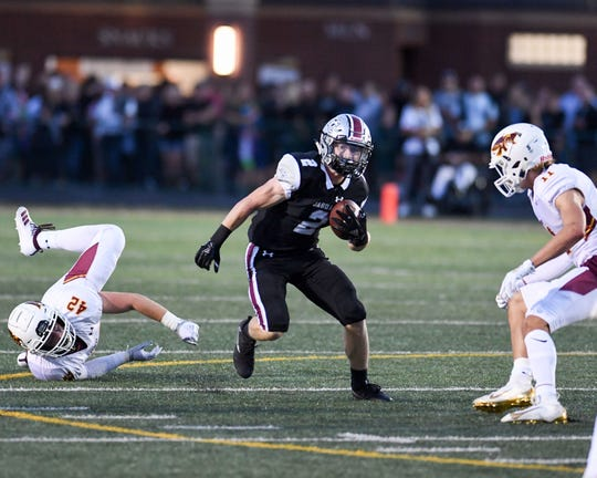 Centennial's Avery Gates (2) scrambles up field on Friday, Aug. 30, 2019 during the season opening game between the Ankeny Hawks and the Ankeny Centennial Jaguars.