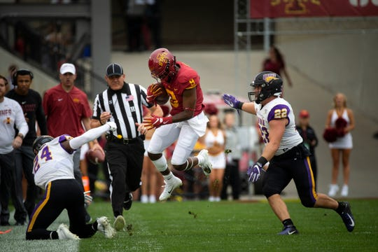 Iowa State wide receiver Deshaunte Jones (Sr.) (8) avoids the tackle of UNI's Omar Brown (24) during their season opening game at Jack Trice Stadium on Saturday, Aug. 31, 2019 in Ames. Iowa State takes a 3-0 lead over UNI into halftime.