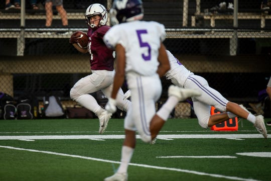 Dowling Catholic's Teagan Johnson (31) looks at Waukee's Aaron Smith (5) as he runs in a touchdown to put Dowling up 7-3 over Waukee during their season opening game at Valley Stadium on Friday, Aug. 30, 2019 in West Des Moines. Waukee takes a 17-14 lead into halftime.
