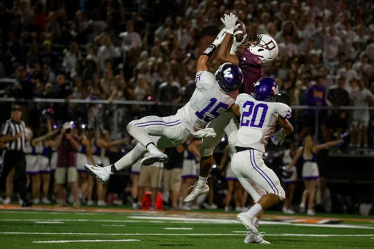 Dowling Catholic's Louis Brooks (2) catches a touchdown pass during their season opening game at Valley Stadium on Friday, Aug. 30, 2019 in West Des Moines. Dowling would go on to win 21-17.