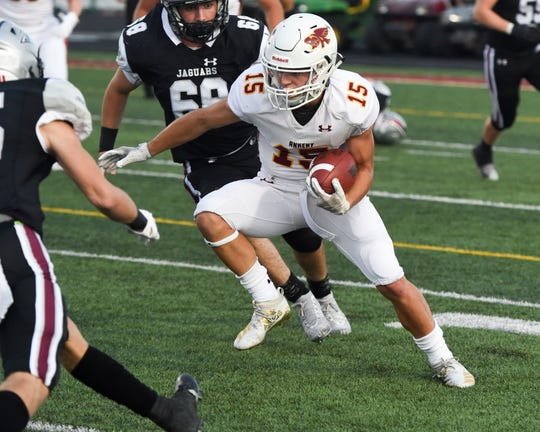 Ankeny's Cael Boyd (15) fights his way through Centennial defenders on Friday, Aug. 30, 2019 during the season opening game between the Ankeny Hawks and the Ankeny Centennial Jaguars.
