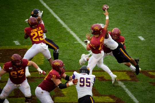 Iowa State quarterback Brock Purdy (So.) (15) just has the ball knocked away by UNI's Elerson G. Smith (16) during their season opening game at Jack Trice Stadium on Saturday, Aug. 31, 2019 in Ames. Iowa State would go on to defeat UNI in triple overtime 29-26.