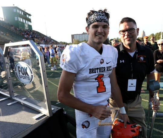 Brother Rice starting quarterback Greg Piscopink and his father and defensive coach Greg Piscopink after Piscopink lead his team to a 7-0 win against Utica Eisenhower during the teams first game at Wayne State University on Thursday, August 29, 2019. Brother Rice won the game 7-0