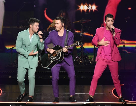 Six years after their breakup, Nick Jonas, left, Kevin Jonas, and Joe Jonas are performing together again.