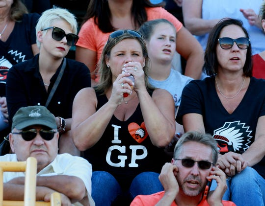 Jennifer Piscopink watches and cheers from the stands while watching her son the Brother Rice starting quarterback Greg Piscopink in his teams game against Utica Eisenhower at  Wayne State University on Thursday, August 29, 2019.  Brother Rice won the game 7-0