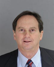 Stuart Sherr, an elected Bloomfield Hills city commissioner, poses for his police booking photo in fall 2018 after being caught stealing political campaign signs shortly before the Nov. 6 election.