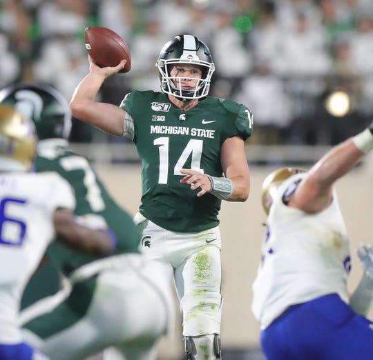 Michigan State Spartans' Brian Lewerke passes against the Tulsa Golden Hurricane, Friday, August 30, 2019 at Spartan Stadium.