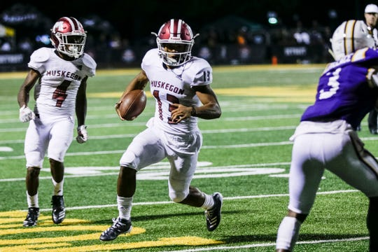 Muskegon quarterback Cameron Martinez (13) runs against Warren De La Salle during the second half of Prep Kickoff Class at Wayne State University's Tom Adams Field in Detroit, Friday, August 30, 2019.