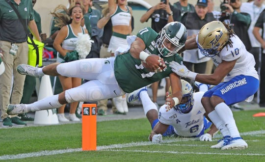 Michigan State Spartans running back Connor Hayward scores a touchdown against the Tulsa Golden Hurricane during the first quarter Friday, August 30, 2019 at Spartan Stadium.