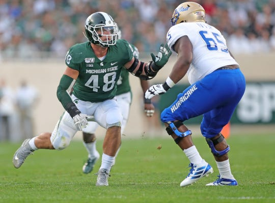 Michigan State Spartans' Kenny Willekes rushes against the Tulsa Golden Hurricane's Chris Ivey, Friday, August 30, 2019 at Spartan Stadium.