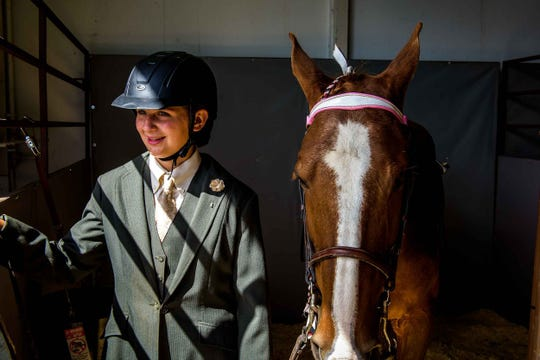 Marianna Rimanelli of South Lyon and her horse Trace prior to the Walking Horse Association of Michigan show at The Michigan State Fair at The Suburban Collection, Novi August 31, 2019.