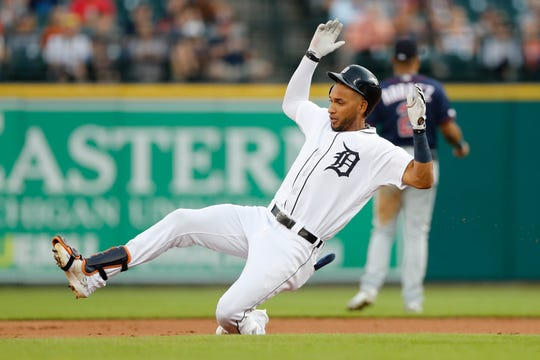 Detroit Tigers' Victor Reyes slides into second for a double during the first inning against the Minnesota Twins, Friday, Aug. 30, 2019, in Detroit.