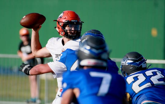 Brother Rice starting quarterback Greg Piscopink drops back to pass during his team's game against Utica Eisenhower at Wayne State University on Thursday, August 29, 2019. Brother Rice won the game 7-0