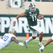 Michigan State Spartans' Connor Heyward runs by the Tulsa defense Friday, August 30, 2019 at Spartan Stadium.
