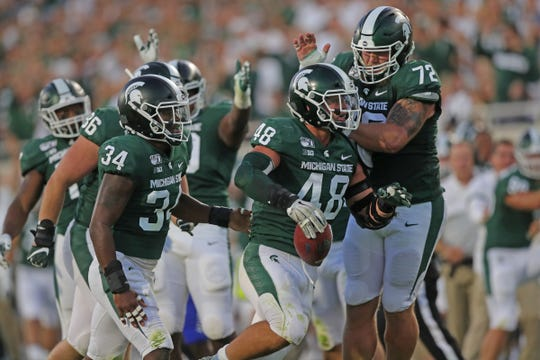 Michigan State Spartans defensive end Kenny Willekes (48) celebrates his fumble recovery with Mike Panasiuk (72) during the first half against the Tulsa Golden Hurricane, Friday, August 30, 2019 at Spartan Stadium.