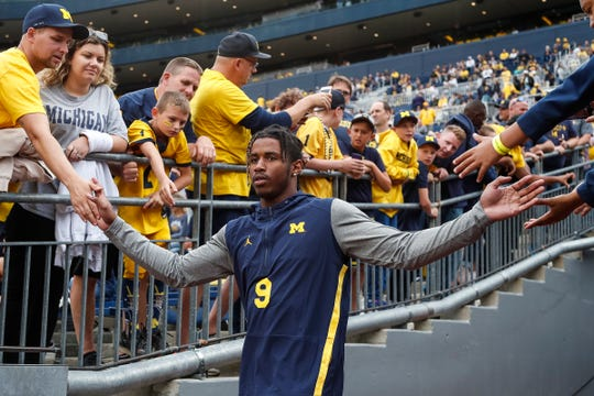 Michigan receiver Donovan Peoples-Jones high-fives fans as he walks down the tunnel for warmups before the Middle Tennessee State game at Michigan Stadium, Saturday, August 31, 2019.