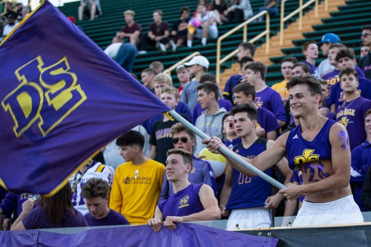 Warren De La Salle students cheer for the Pilots during the first half of Prep Kickoff Class against Muskegon at Wayne State University's Tom Adams Field in Detroit, Friday, August 30, 2019.