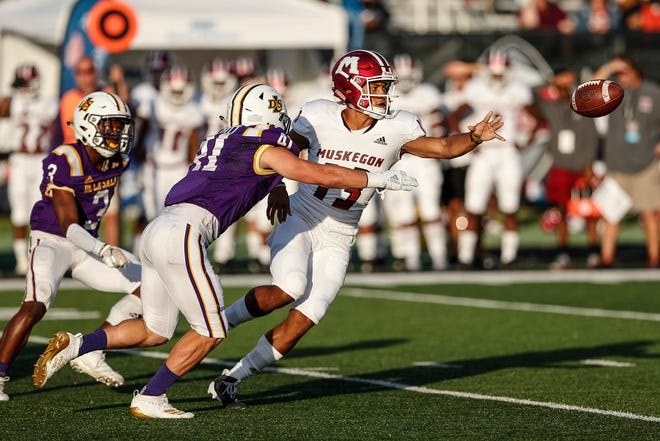 Muskegon quarterback Cameron Martinez (13) makes a pass against Warren De La Salle during the first half of Prep Kickoff Class at Wayne State University's Tom Adams Field in Detroit, Friday, August 30, 2019.