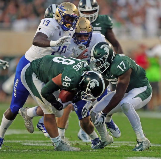 MSU's Kenny Willekes recovers a fumble during the first half against Tulsa on Friday night.
