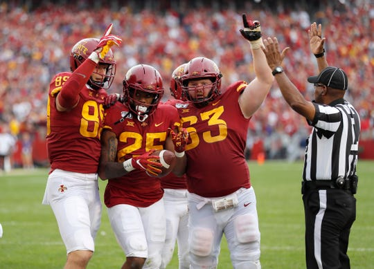 Iowa State's Brian Papazian, left, Sheldon Croney, center, and Collin Olson, right, celebrates Croney's winning touchdown during the third overtime against Northern Iowa on Saturday.