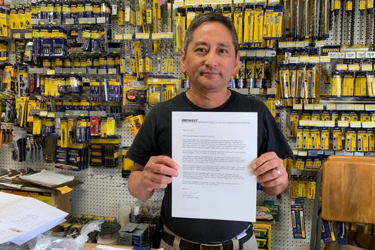 Albert Chow, owner of Great Wall Hardware in San Francisco, holds a May 2019 letter from a supplier notifying him that prices will be increasing 10 to 18 percent because of U.S. tariffs on Chinese goods.