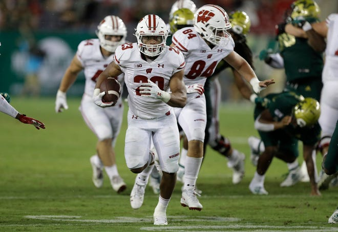 Wisconsin running back Jonathan Taylor (23) scores against South Florida during the second half on Friday.