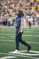Michigan wide receiver Donovan Peoples-Jones walks the field in a boot during pregame warmups.