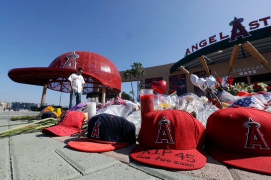 Angel Lozano looks over at a memorial as he give his condolences for Los Angeles Angels pitcher Tyler Skaggs outside Angel Stadium last month.