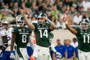 Michigan State quarterback Brian Lewerke (14) celebrates after running the ball for a first down in the second quarter.