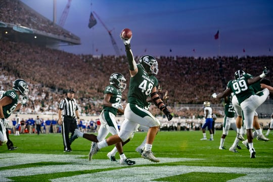 Michigan State defensive end Kenny Willekes celebrates after recovering a fumble in the end zone for a touchdown in the second quarter.