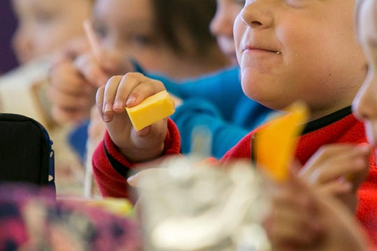 FILE - In this Monday, Oct. 29, 2018 file photo, kids eat lunch at an elementary school in Paducah, Ky. It is far easier to avoid gaining weight than to lose it, so getting kids to eat well and exercise is crucial. But how to do that effectively is extremely difficult — and sensitive.