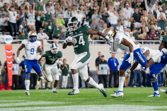Michigan State running back Elijah Collins runs into the end zone in the third quarter but the play was called back due to a holding penalty.