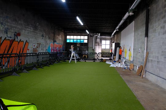 A former oil shop was converted into Detroit Soccer District's interior.