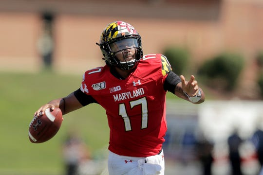 Quarterback Josh Jackson (Saline High) tosses four touchdowns in his first game for Maryland.