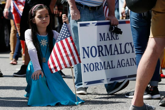 Maria Harrington, 8, of Lowell, Mass., waits to march in the Straight Pride Parade in Boston, Saturday, Aug. 31, 2019.