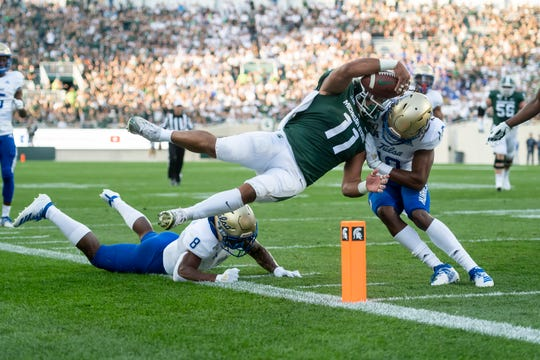 Michigan State running back Connor Heyward leaps for a  touchdown in the first quarter.
